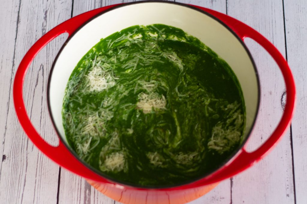 green soup with lemon juice, parmesan and cottage cheese added