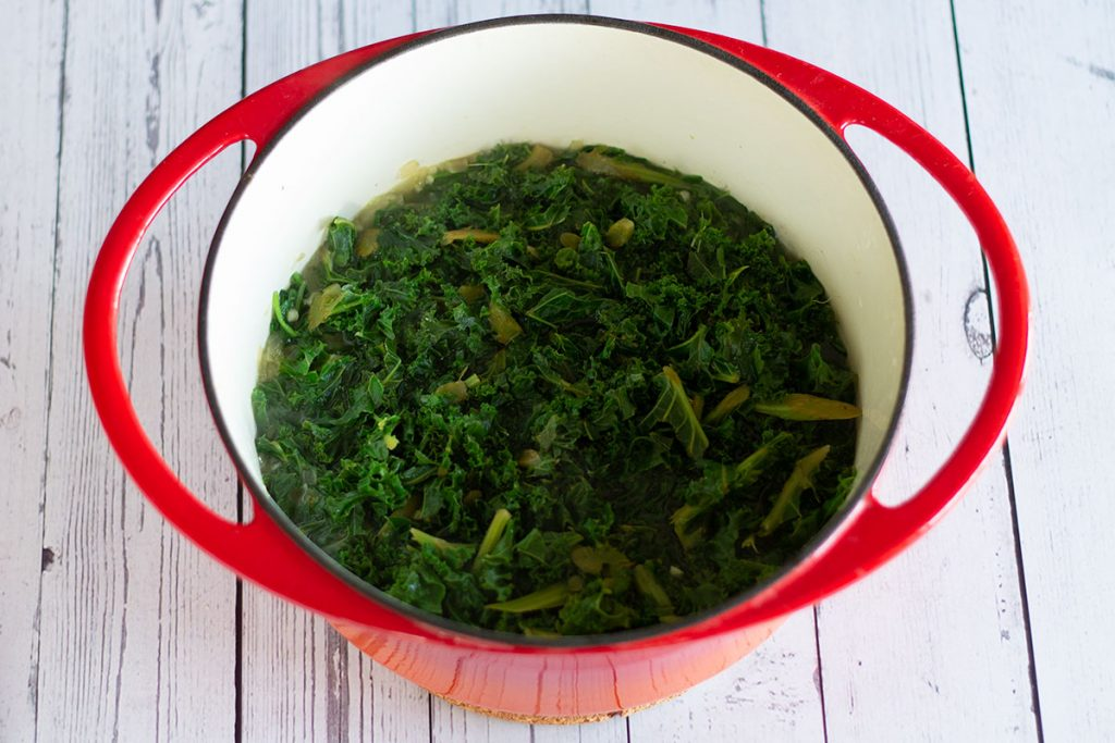 kale and spinach simmering in vegetable stock