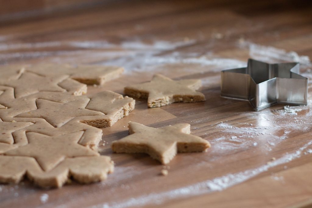 Spiced biscuit dough cut into star shapes