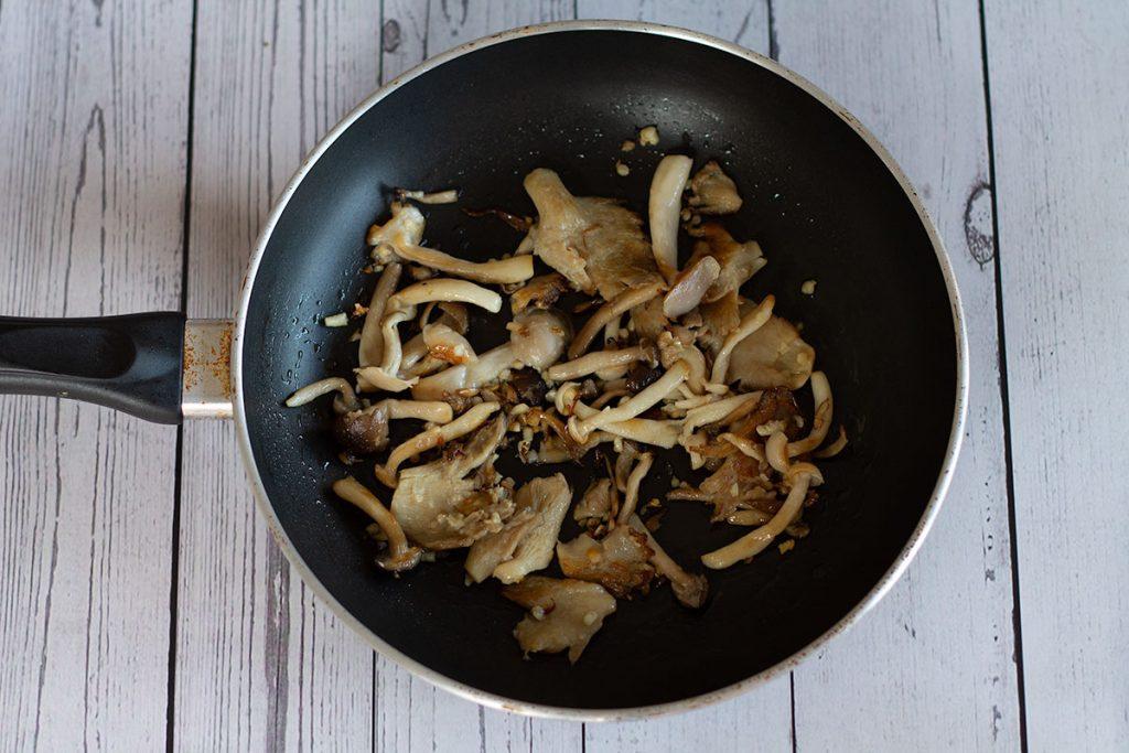 browned garlic mushrooms in frying pan