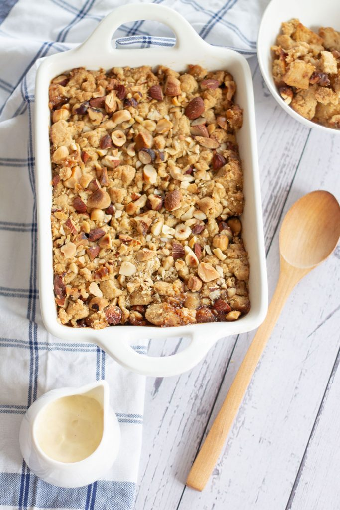 baked spiced apple crumble with a jar of custard on the side