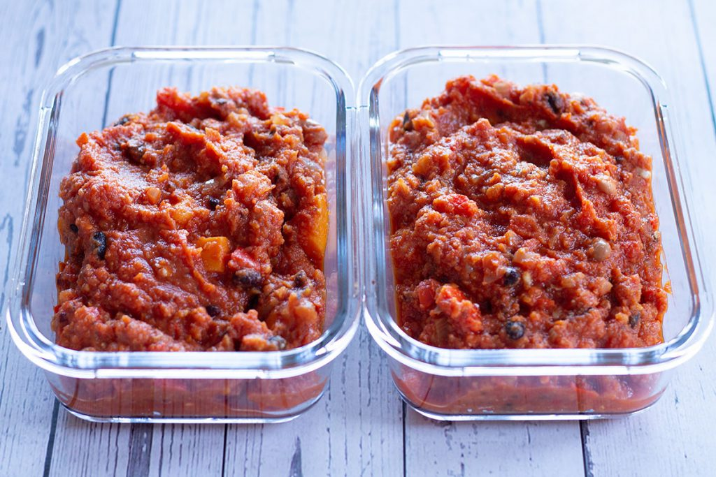 vegan sweet potato chilli in storage containers ready to be frozen