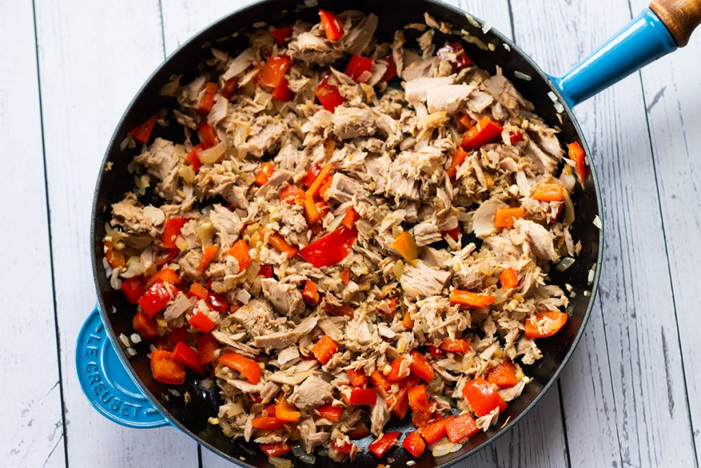 pan with cooked onions, peppers, garlic and tuna