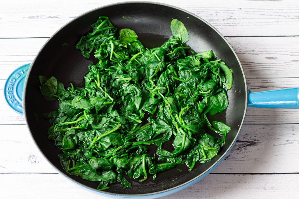wilted spinach in a pan