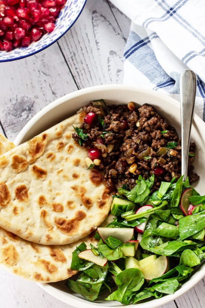 lamb mince, flatbread and salad in a bowl