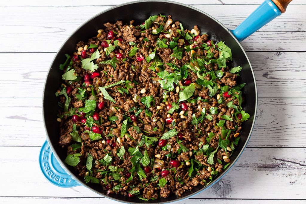 cooked lamb mince with pomegranate seeds, herbs and pine nuts