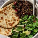 bowl of lamb mince with flatbread and salad