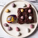 Cream and Mini Egg brownie on a plate
