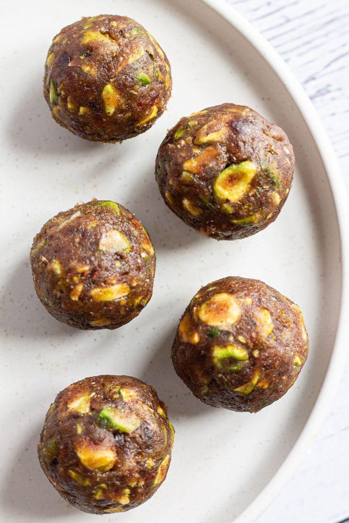 Pistachio Date Balls on a plate