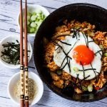 Plated kimchi friend rice with toppings