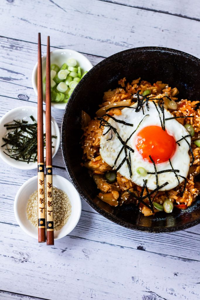 Plated chicken kimchi fried rice with toppings
