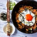 chicken kimchi fried rice served with toppings
