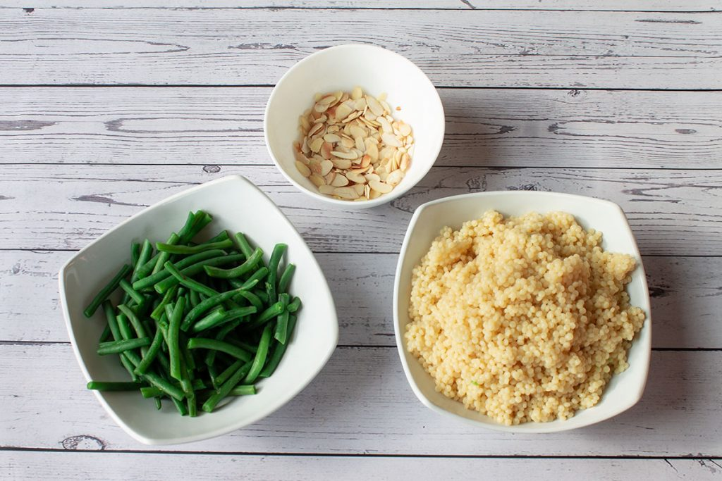 Cooked beans, couscous and flaked almonds
