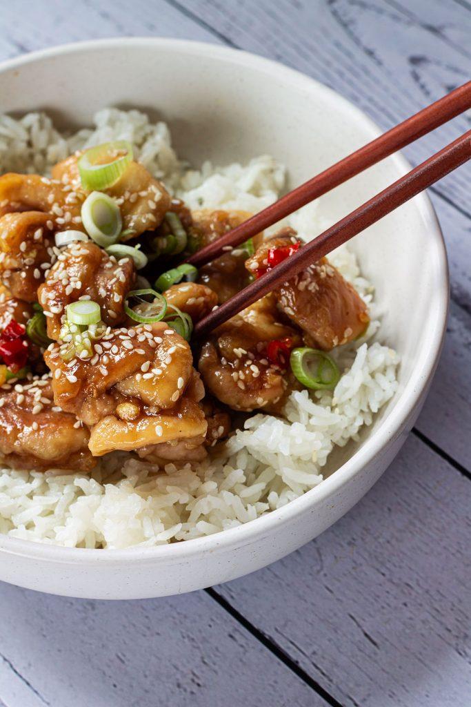 Speedy and Spicy Sesame Chicken with chopsticks