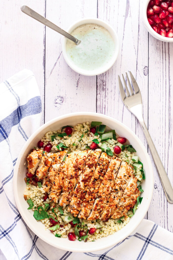 dukkah crusted chicken served with the yoghurt dressing on the side