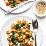 Servings of Fried Gnocchi With Feta, Spinach and Pine Nuts